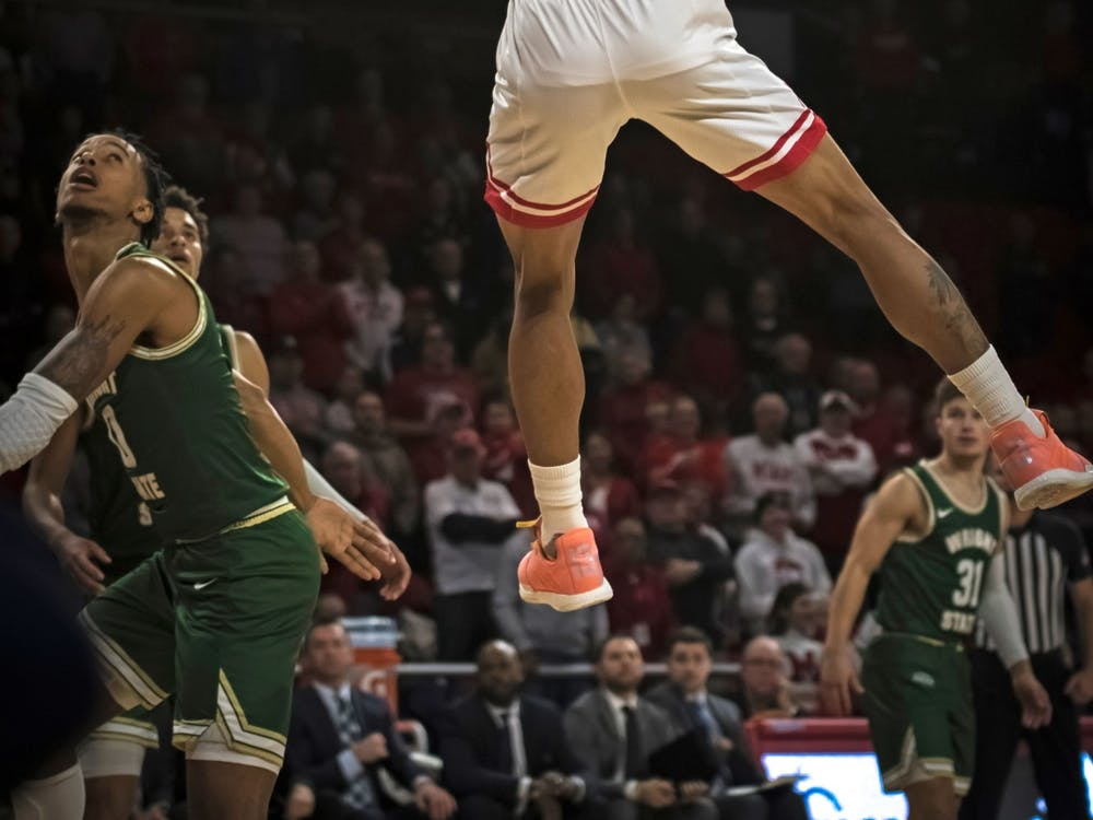 Junior guard Nike Sibande dunks an alley-oop pass for Miami's first points of the 2019-2020 season on Nov. 9 at Millett Hall. Sibande, who flirted with the National Basketball Association in the offseason, scored 24 points in the RedHawks' 88-81 loss to Wright State.