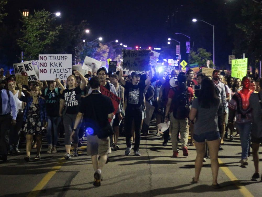 The rally swelled as it progressed past Benton Hall, joined by students off the street.  Photo by Ryan Terhune