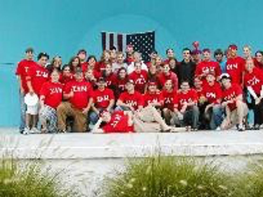 Members of Sigma Alpha Mu, Zeta Tau Alpha and Alpha Epsilon Pi take a break Saturday morning during the American Heart Association Heart Walk.