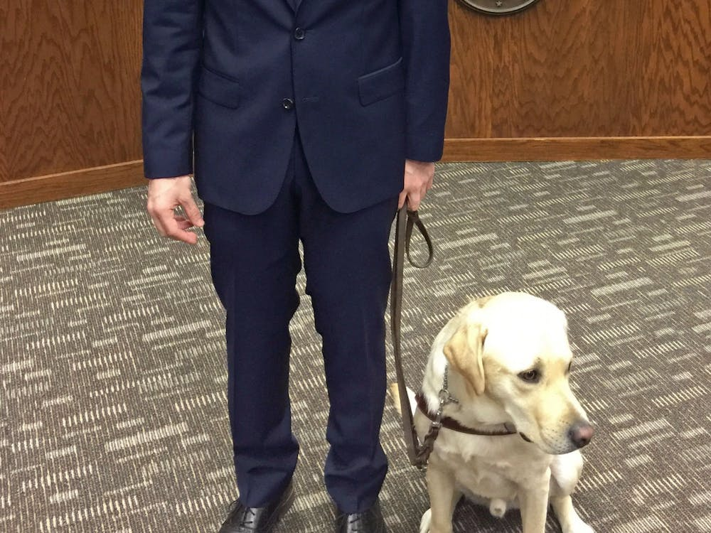Michael Molchan received his guide dog, Hawkins, as a present on his 18th birthday.