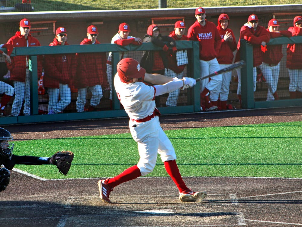 Senior Landon Stephens swings during a 7-3 Miami victory over Purdue Fort Wayne Saturday at Hayden Park.