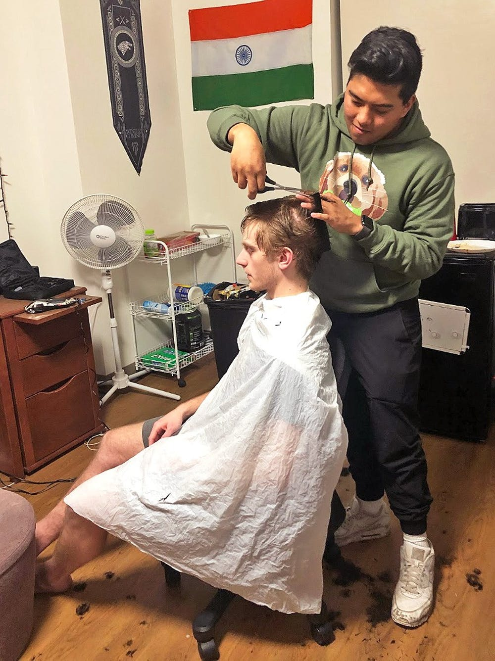 <p>Tucson snips and socializes giving his clients a unique haircutting experience.</p>