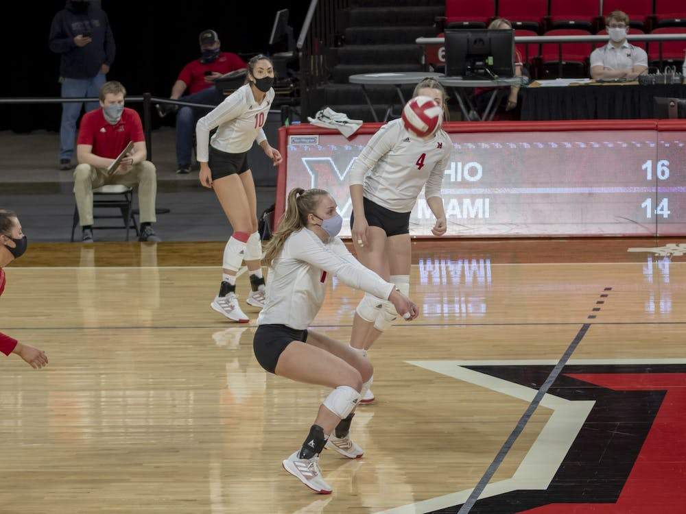 Junior libero Jaquelyn Krumnauer (middle) executes a bump in a spring 2021 match against Ohio University.