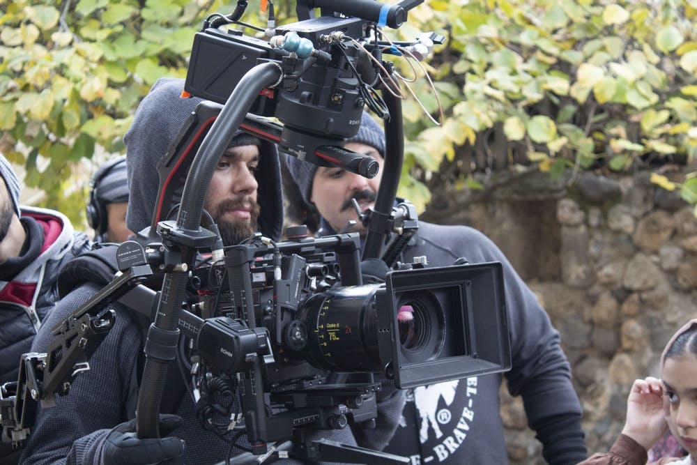 <p>Professor A.J. Rickert-Epstein (pictured in center of camera apparatus) plays double duty as a visiting professor at Miami and as a cinematographer. </p>