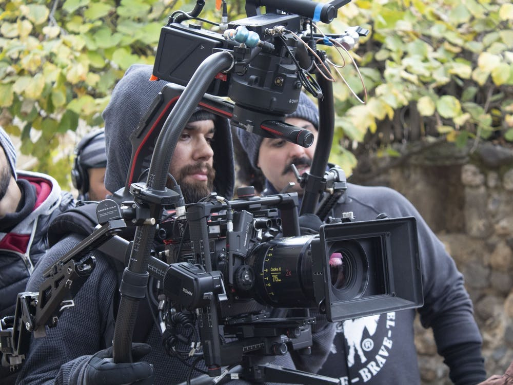 Professor A.J. Rickert-Epstein (pictured in center of camera apparatus) plays double duty as a visiting professor at Miami and as a cinematographer.