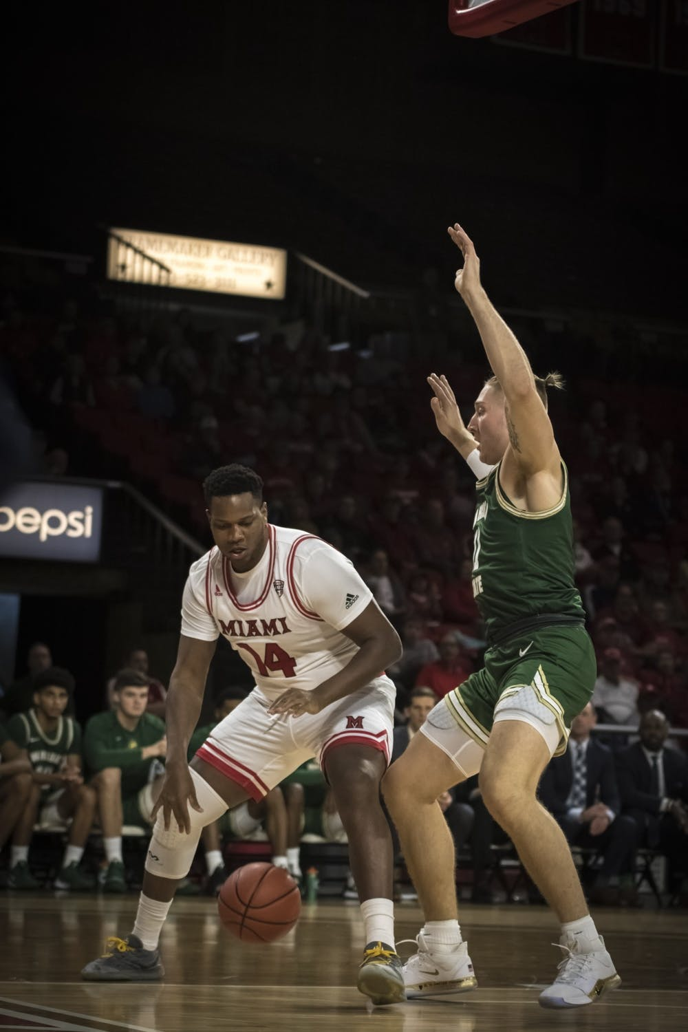 <p>Senior forward Bam Bowman posts up against a Wright State defender Nov. 9 at Millett Hall. Bowman scored four points during an 88-81 Miami loss.</p>