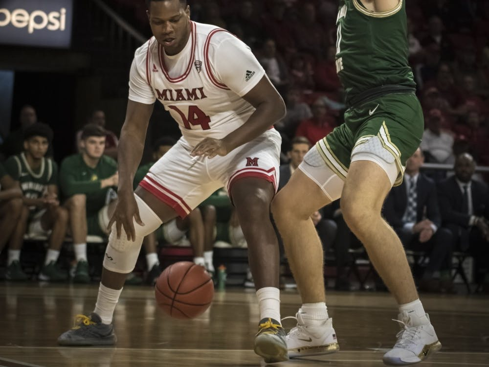 Senior forward Bam Bowman posts up against a Wright State defender Nov. 9 at Millett Hall. Bowman scored four points during an 88-81 Miami loss.