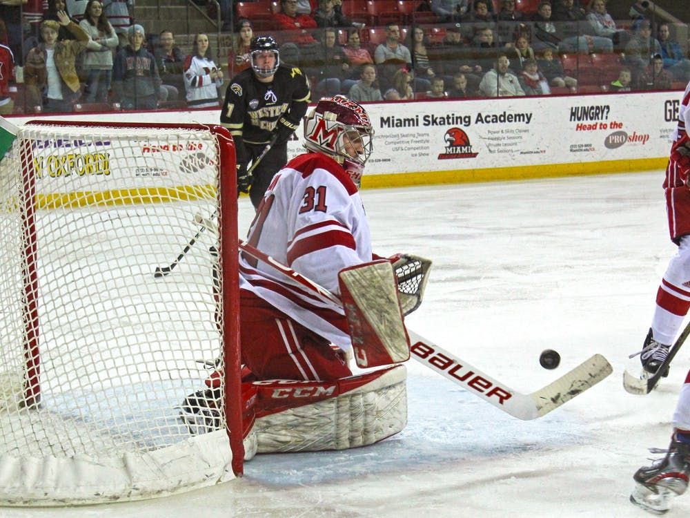 Senior goaltender Ryan Larkin hurries to block a shot in a 2-2 tie against Western Michigan on Feb. 14 at the Goggin Ice Center. Larkin stopped 26 shots.
