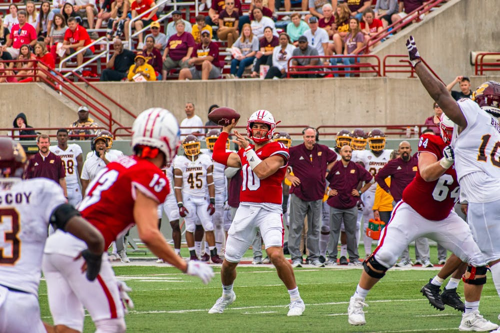 Redshirt sophomore quarterback AJ Mayer looks to throw to sixth-year senior wide receiver Jack Sorenson in Miami's 28-17 over Central Michigan.