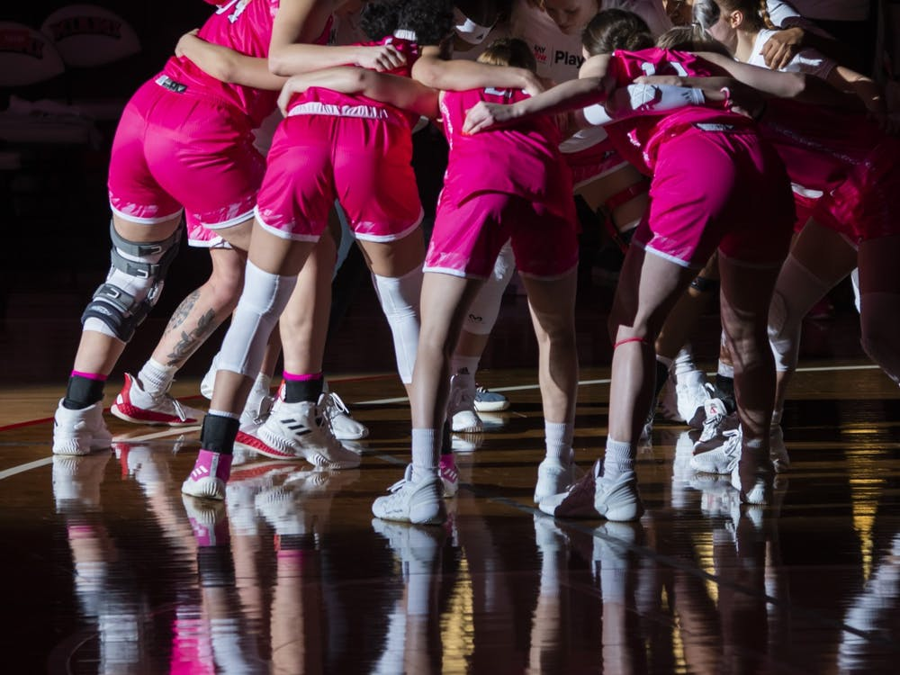 The women's basketball team huddles up before its game against Western Michigan. The game ended with the RedHawks breaking a 13-game losing streak.
