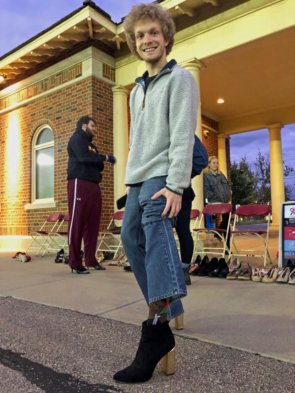 <p>Students walk around Cook Field in high heels to raise awareness for sexual assault survivors. </p>