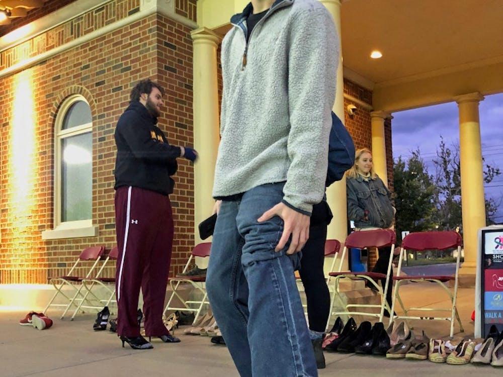 Students walk around Cook Field in high heels to raise awareness for sexual assault survivors.