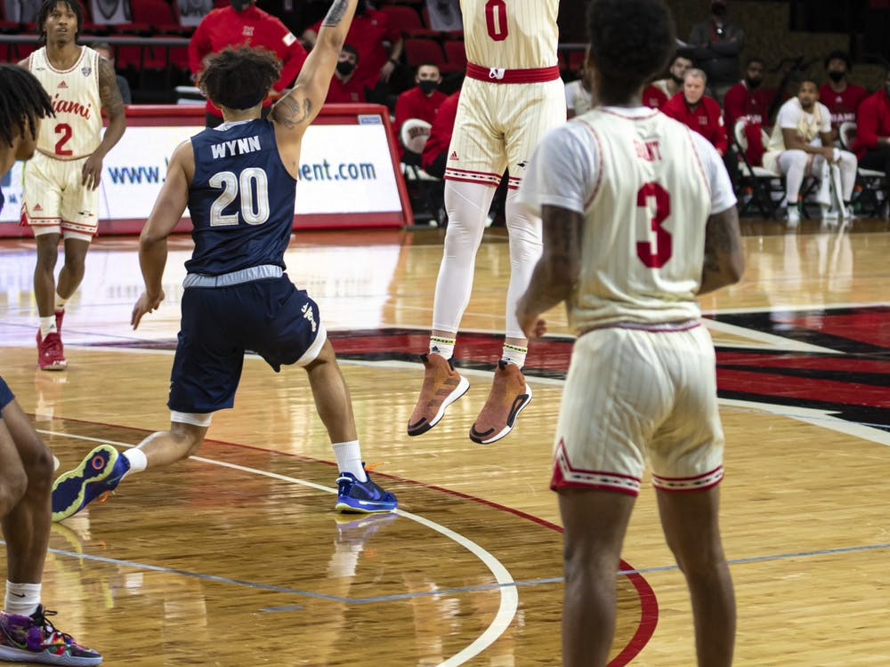 Redshirt freshman forward Javin Etzler attempts a 3-pointer in a Feb 12 loss to Akron