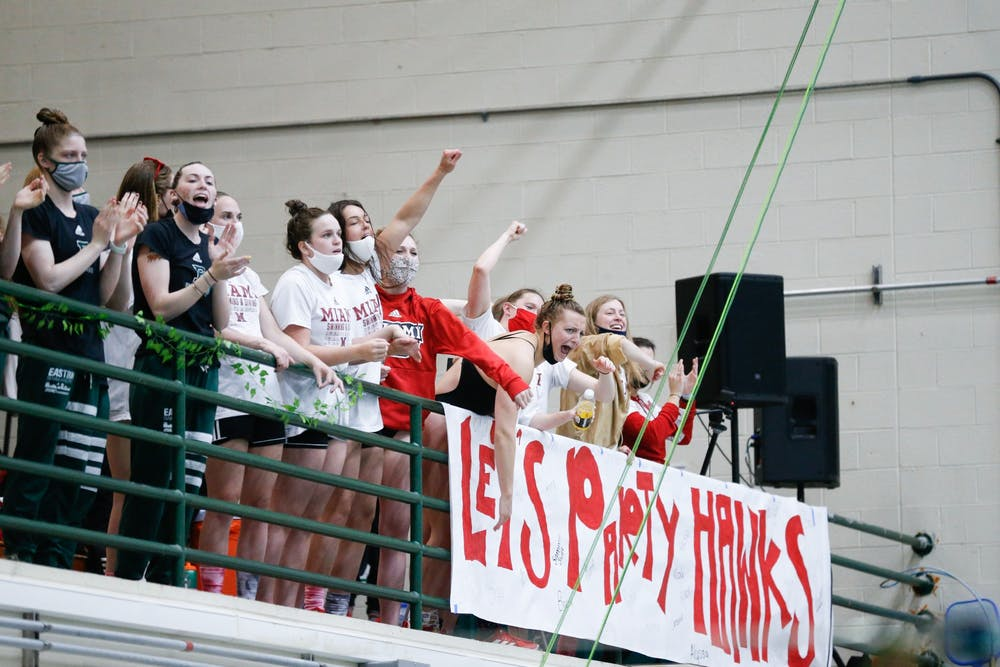 <p>RedHawk swimmers cheer on their teammates during last weekend&#x27;s MAC championship meet.</p>