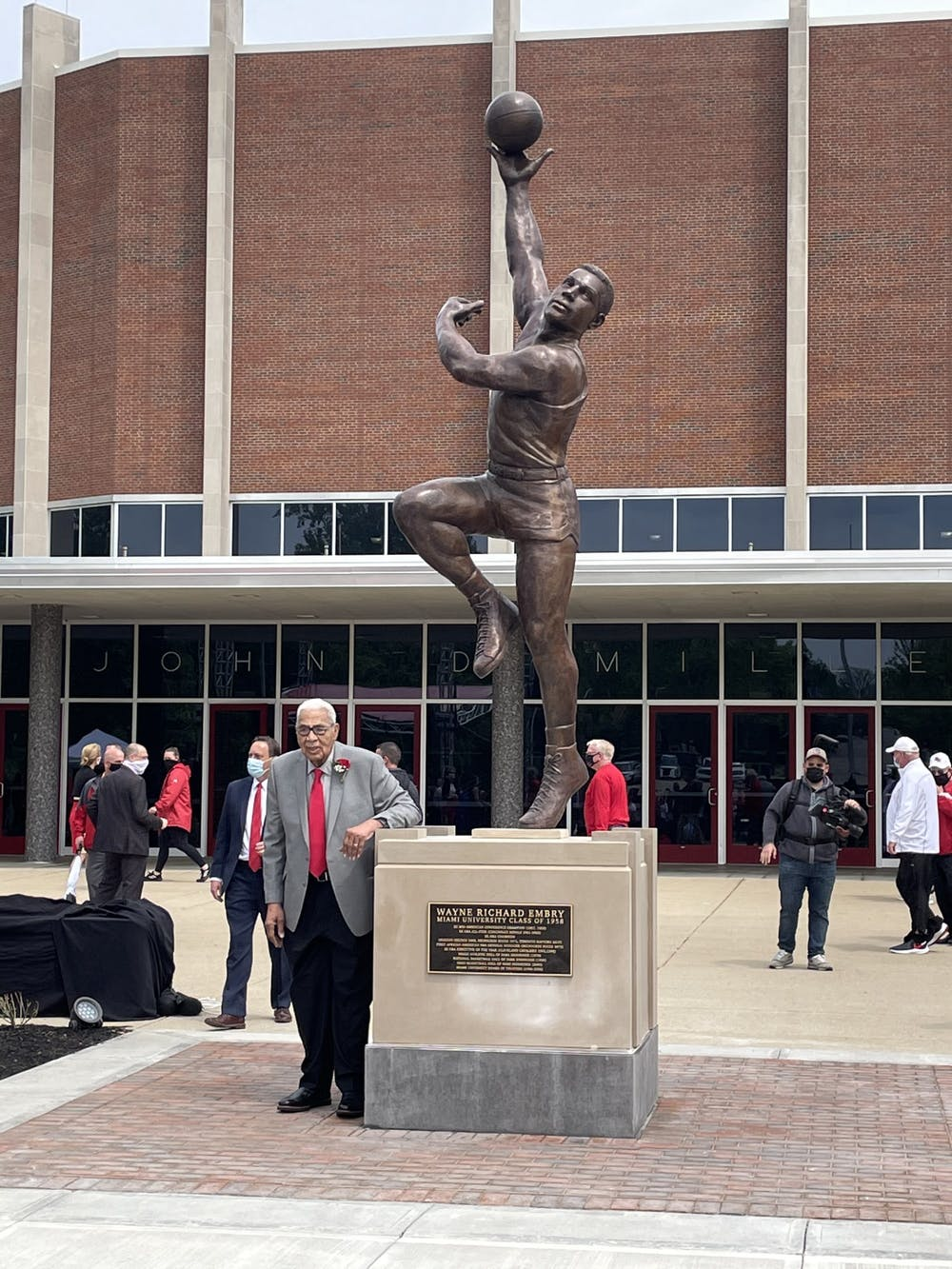 Wayne Embry with his new likeness in front of Millett Hall