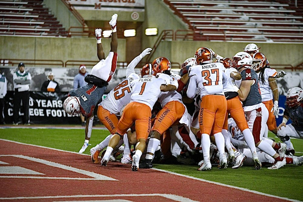 <p>Junior running back Jaylon Bester flips into the end zone for a touchdown during Miami&#x27;s 44-3 rout of Bowling Green Wednesday at Yager Stadium.</p>