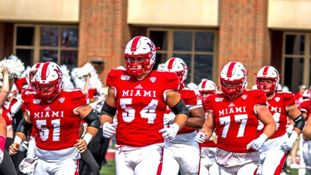 Then-redshirt junior offensive lineman Tommy Doyle (No. 54) leads the RedHawks onto the Yager Stadium turf before Miami's Sept. 28 showdown with Buffalo.