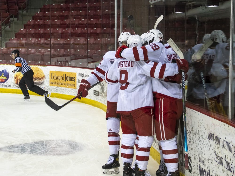 Several RedHawks celebrate a goal during a Feb 13 loss to St Cloud State