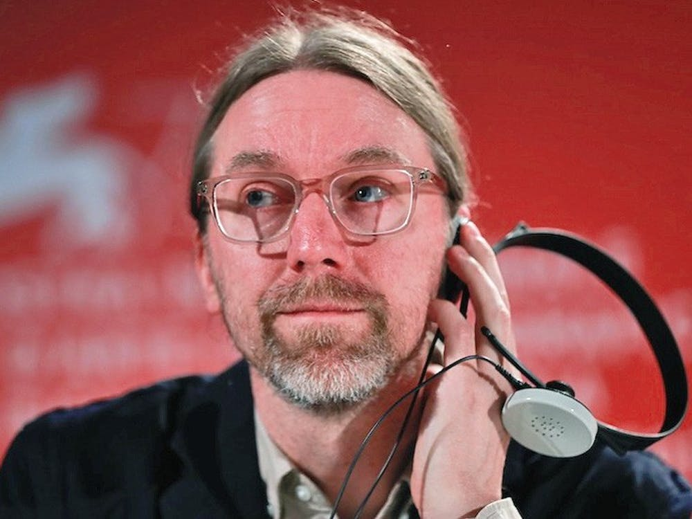 Kajganich on a panel at the Venice Film Festival.