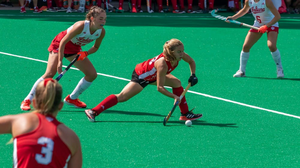 Junior midfielder Luli Rosso (middle) passes the ball to a teammate in Miami's 1-0 home loss to Indiana University.