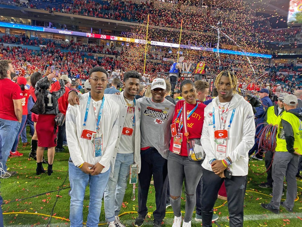 <p>(From left to right) Daeh McCullough, Deland McCullough II, Deland McCullough, Darnell McCullough and Dasan McCullough take a family photo on the field after the Super Bowl.</p>