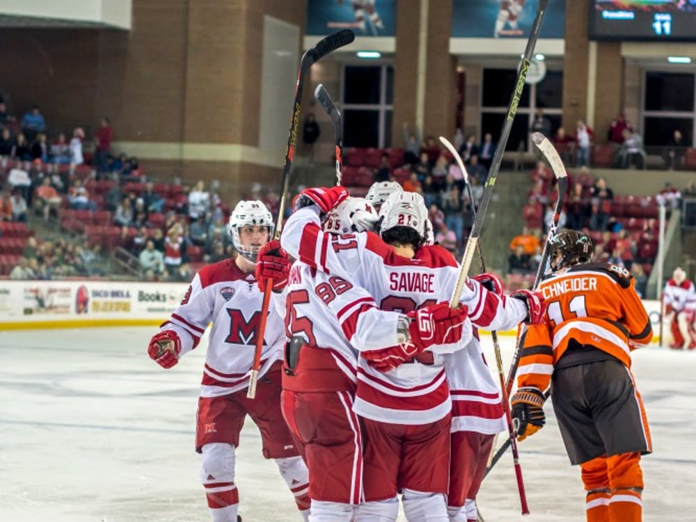 Five RedHawks celebrate against Bowling Green at the Goggin Ice Center Sunday. In his first year as head coach, Chris Bergeron is trying to create a new culture.