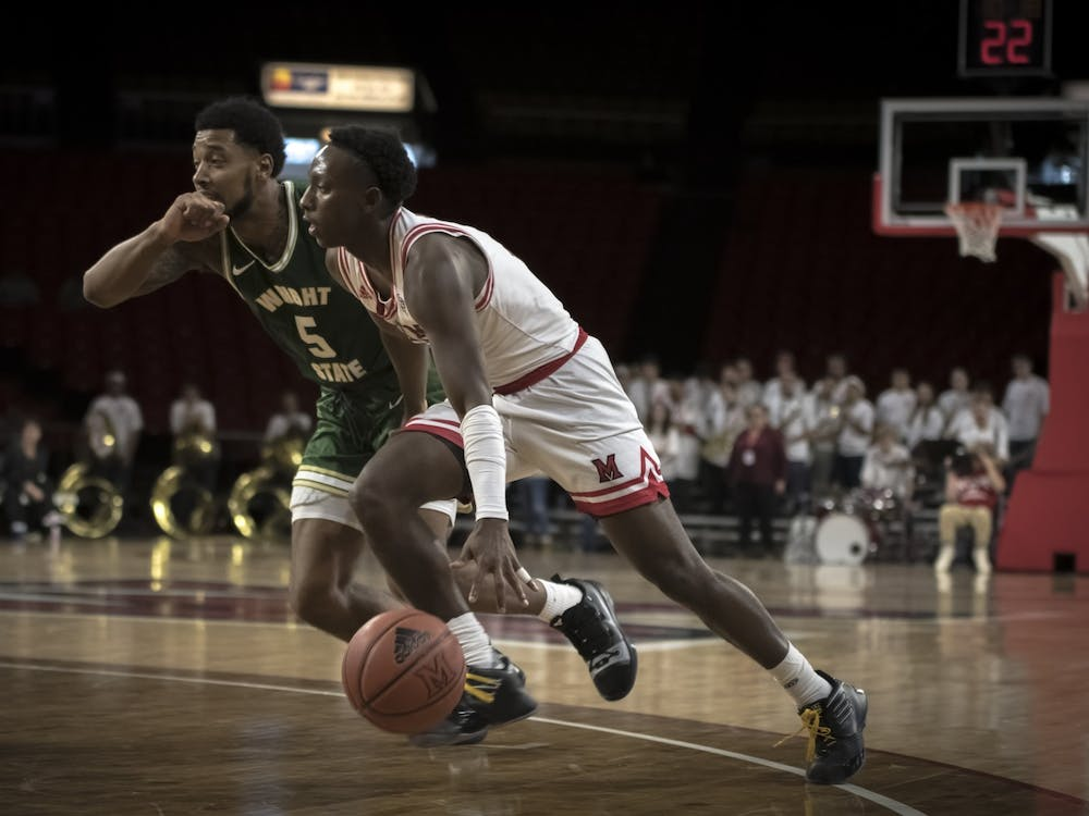 Isaiah Coleman-Lands drives past a Wright State defender during Miami's season-opening loss to the Raiders on Nov. 9, 2019. Coleman-Lands averaged eight points per game during the 2019-20 season.