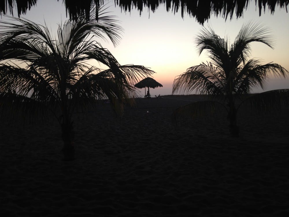 The sun setting over the beach after a long day.