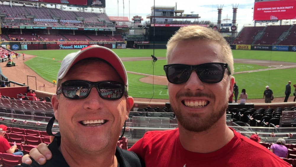 Todd (left) and Brady Pfister get ready to take in the final Cincinnati Reds home game of 2019.
