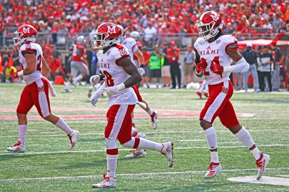 <p>The RedHawks run toward the sidelines during a 76-5 loss to Ohio State on Sept. 21 at Ohio Stadium. Since then, Miami has won three of its four games.</p>
