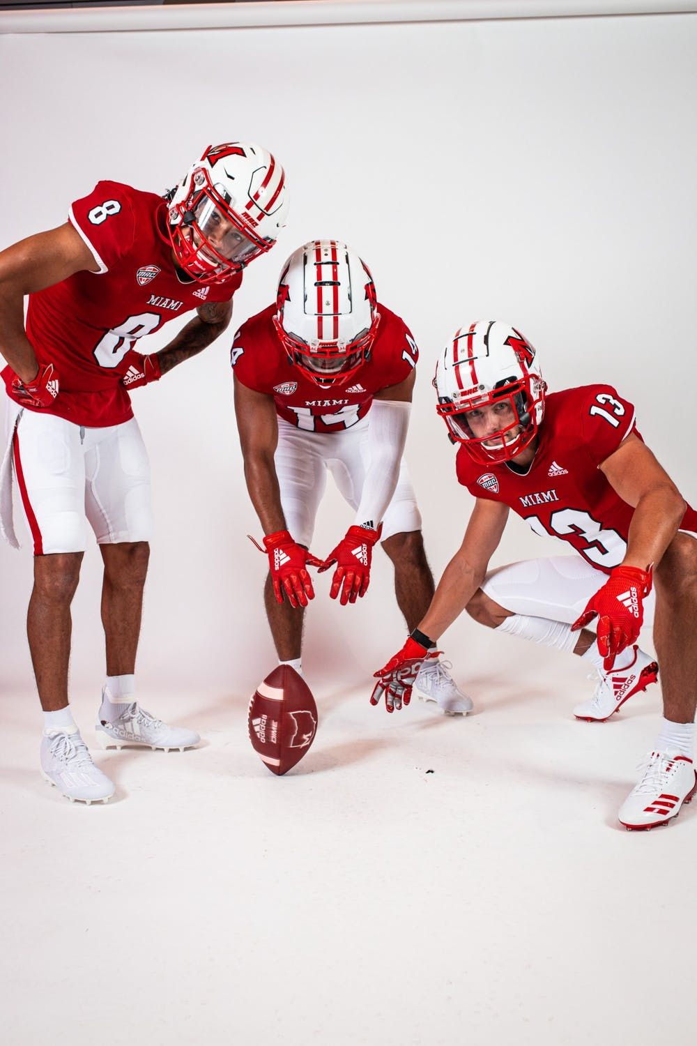 <p>(from left to right) wide receivers Mac Hippenhammer, Jalen Walker and Jack Sorenson pose in Miami&#x27;s new uniforms.</p>