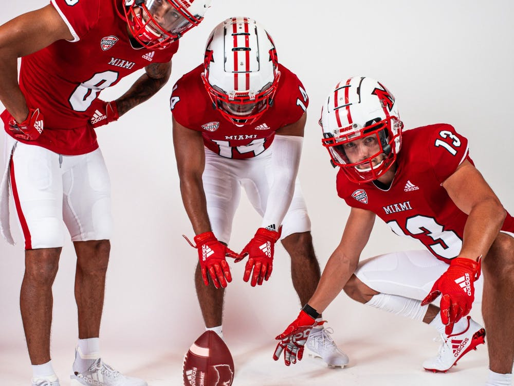 (from left to right) wide receivers Mac Hippenhammer, Jalen Walker and Jack Sorenson pose in Miami's new uniforms.