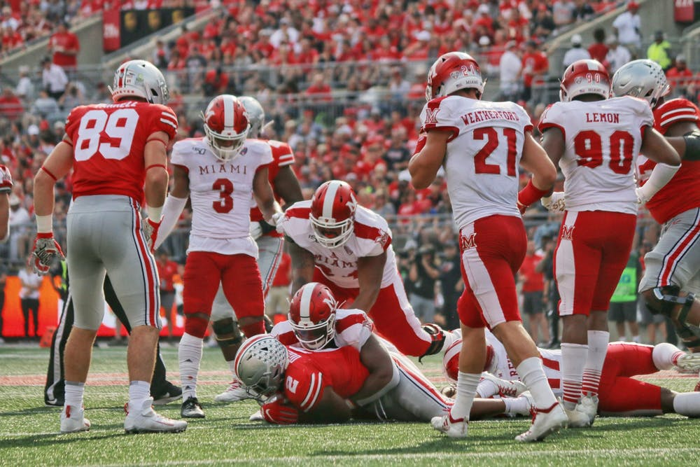 <p>Miami tackles Ohio State running back JK Dobbins during a 76-5 Buckeye victory Sept. 21 at Ohio Stadium. </p>