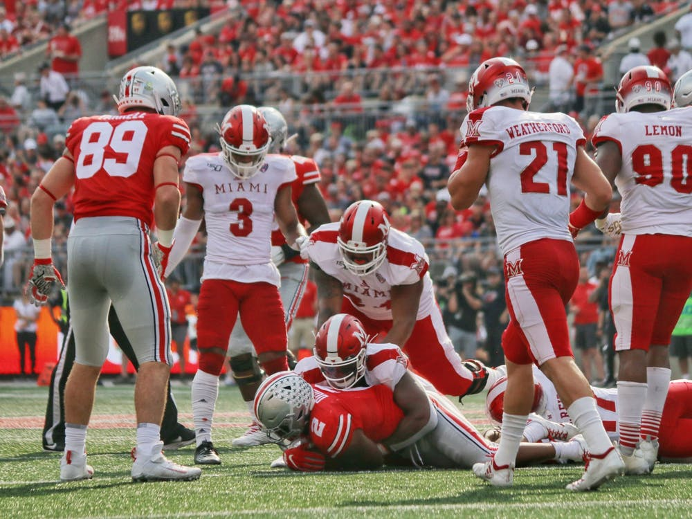Miami tackles Ohio State running back JK Dobbins during a 76-5 Buckeye victory Sept. 21 at Ohio Stadium.