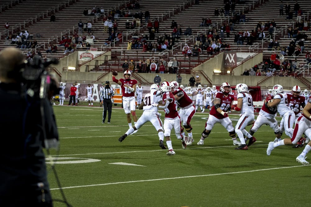 <p>AJ Mayer throws to freshman running back Kevin Davis during Miami&#x27;s 38-31 win Nov. 4 at Yager Stadium. Mayer had attempted his first collegiate pass earlier in the game.</p>