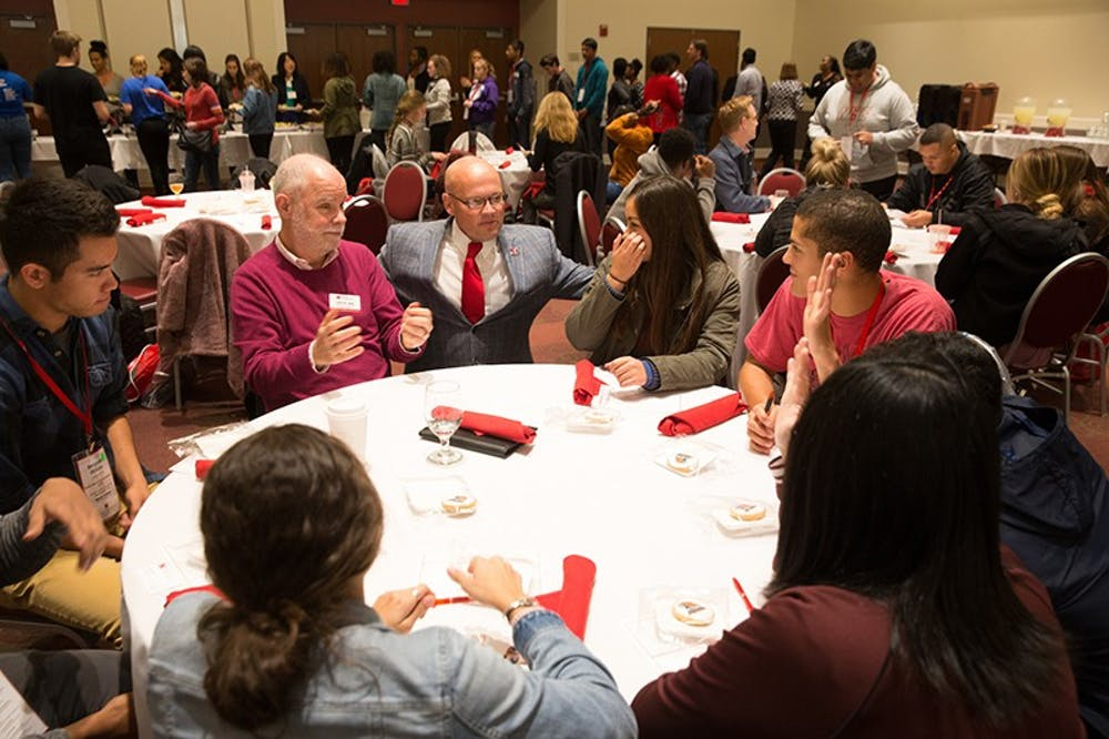 <p>President Gregory Crawford has lunch with a group of Bridges Scholars back in 2017. The prestiged program celebrates its 40th anniversery this year.</p>