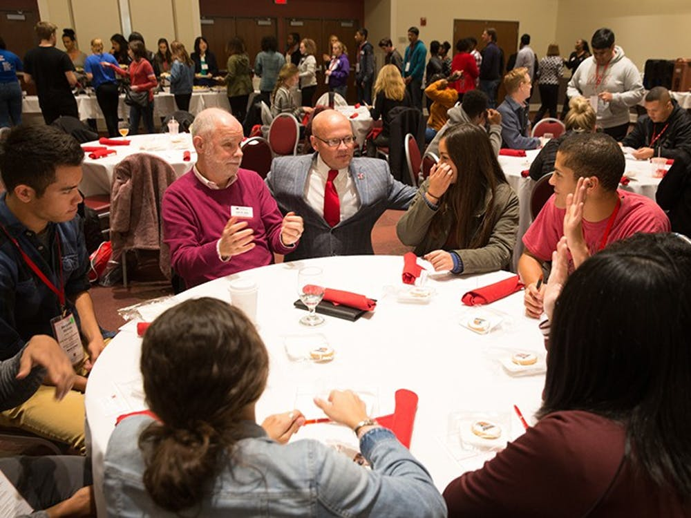 President Gregory Crawford has lunch with a group of Bridges Scholars back in 2017. The prestiged program celebrates its 40th anniversery this year.