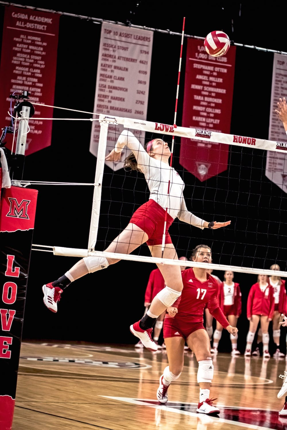 <p>Senior libero Abigail Huser (pictured, in red) recorded a team-high 38 total digs in Miami&#x27;s weekend series against Western Michigan</p>