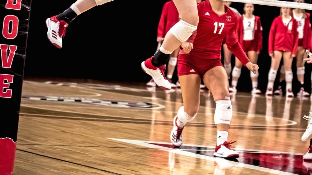Senior libero Abigail Huser (pictured, in red) recorded a team-high 38 total digs in Miami's weekend series against Western Michigan