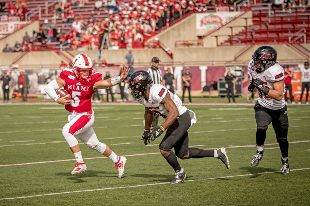 <p>Freshman quarterback Brett Gabbert stiff-arms a Northern Illinois defender on Oct. 19 at Yager Stadium.</p>