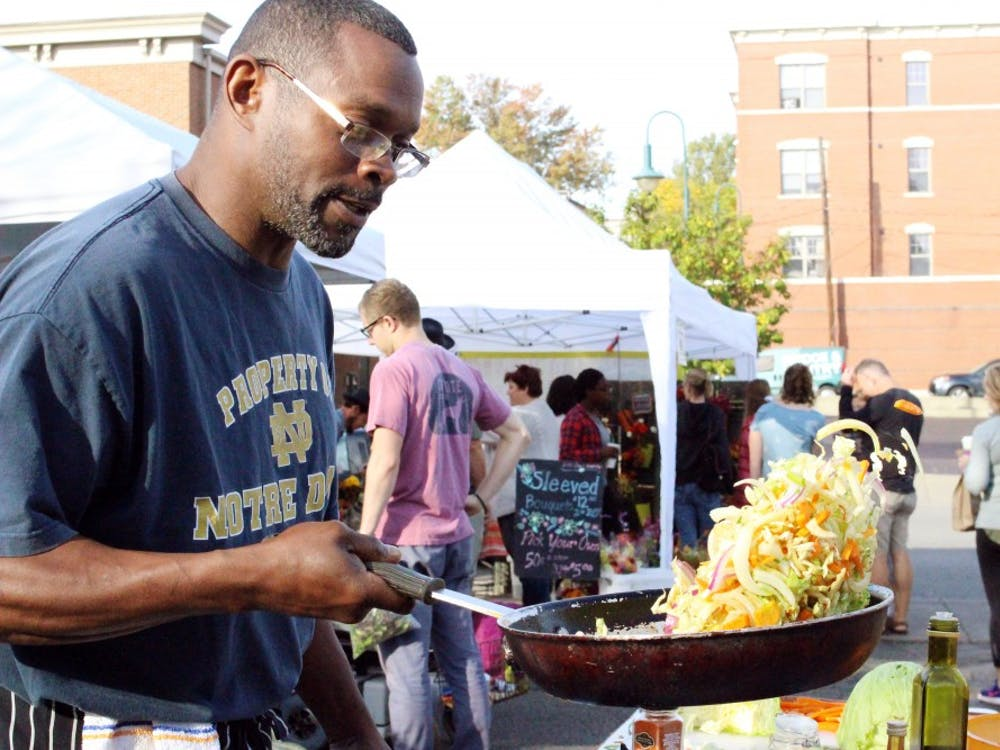 Steve Townsend fries up fresh vegetables at the Oxford Farmers' Market.