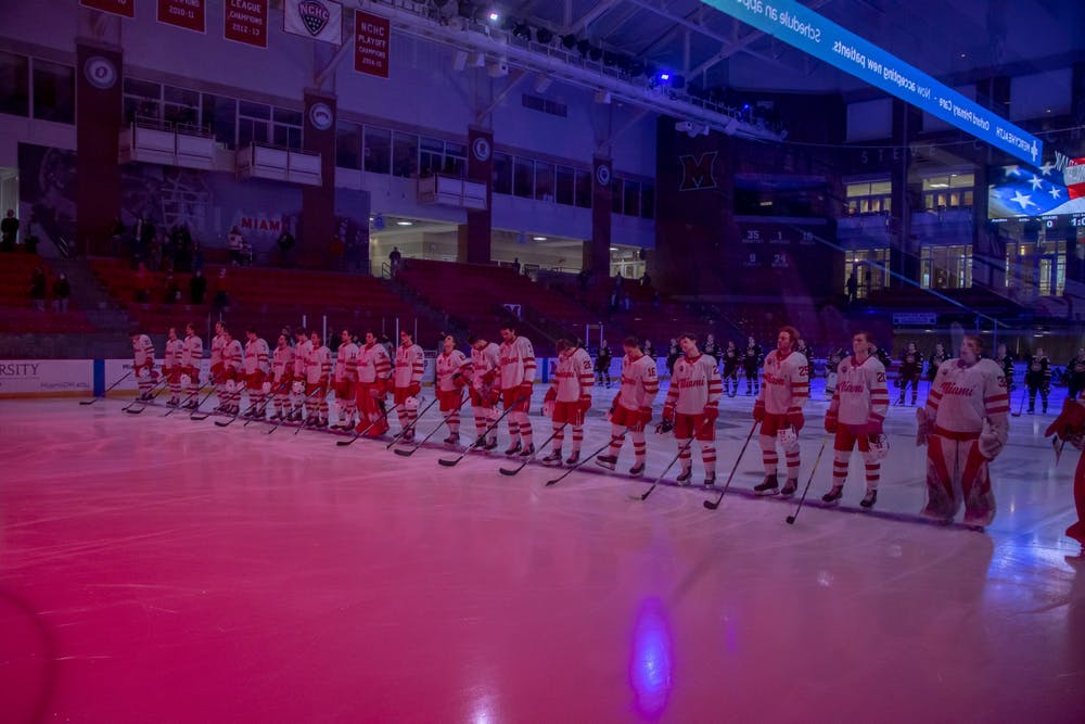 <p>The Miami RedHawks stand at center ice for the Star Spangled Banner before a Feb. 12 contest against St. Cloud State.</p>