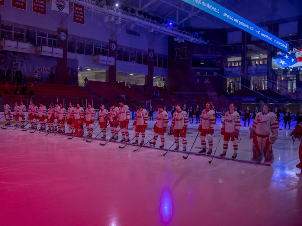 The Miami RedHawks stand at center ice for the Star Spangled Banner before a Feb. 12 contest against St. Cloud State.