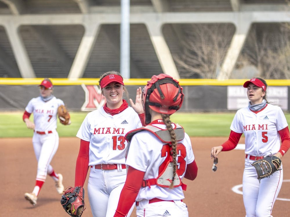 Senior pitcher Courtney Vierstra high-fives junior catcher Allie Cummins during a weekend series vs Buffalo.