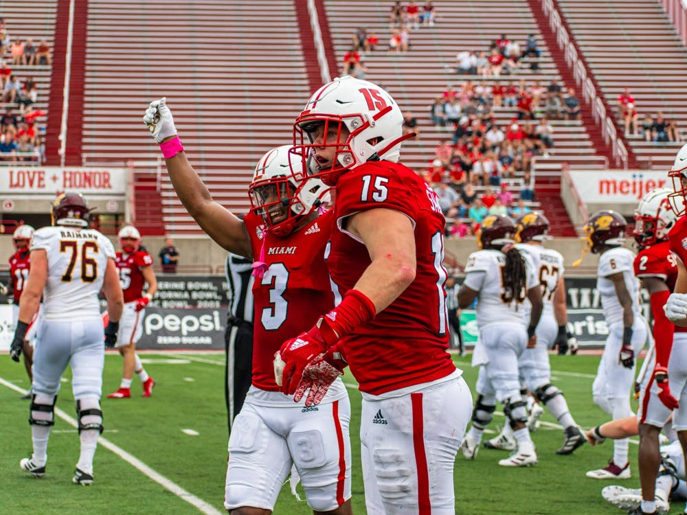 Senior defensive back Mike Brown and redshirt freshman defensive back Matthew Salopek celebrate during Miami's Oct. 2 28-17 win against Central Michigan.