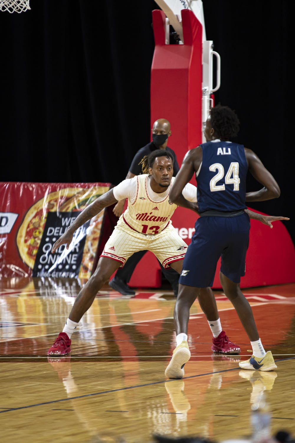 <p>Senior forward Dalonte Brown (pictured, no. 13) gets down in a defensive stance during a loss to Akron.</p>