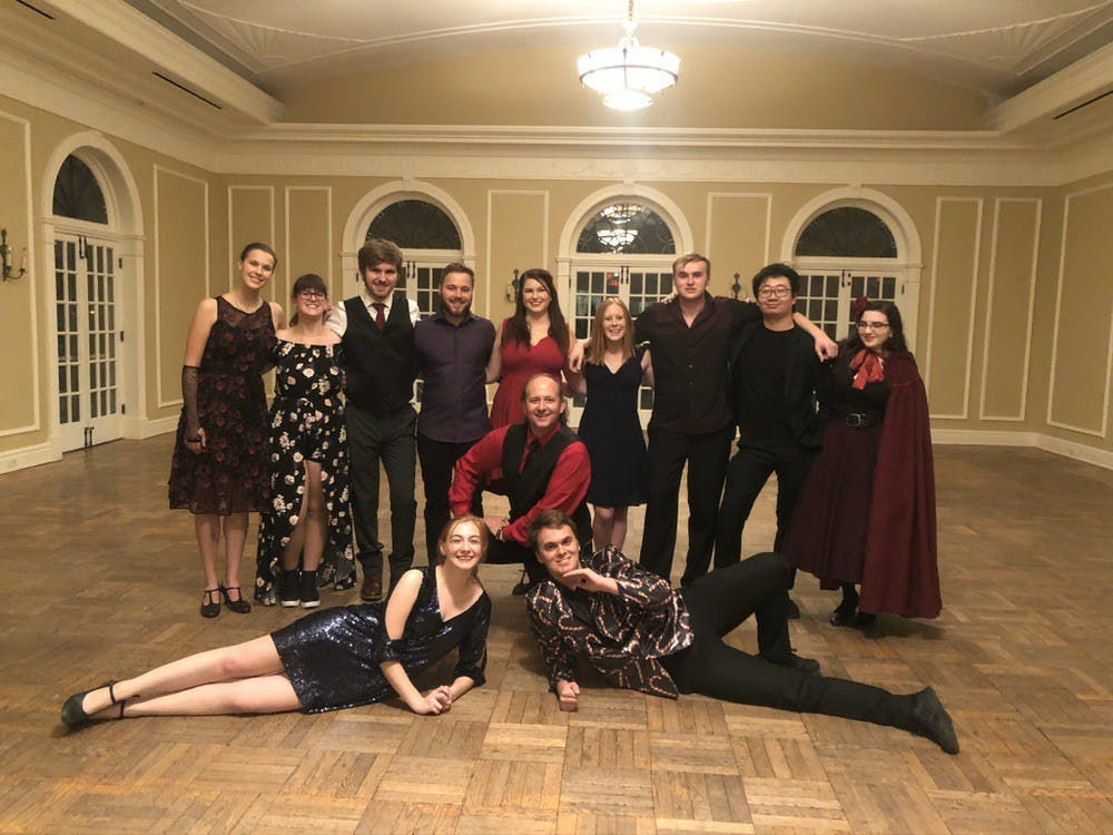 Visiting faculty member Michael Scoggins (center), who has been teaching two-credit-hour social dance classes at Miami for 17 years is losing his job due to budget cuts across the university. A group of his undergraduate assistants (UAs) have made a separate petition to reinstate him.