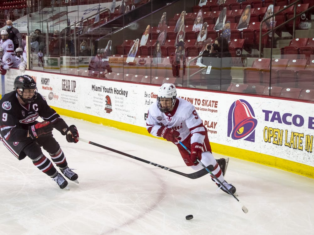 Senior forward Jack Olmstead handles the puck during a 2021 contest vs. St. Cloud State.
