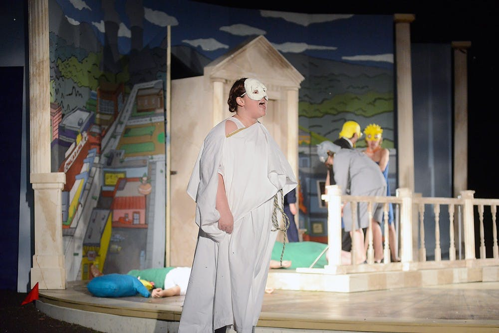 <p>In one of her final productions, Masters Acting graduate Carolyn Conover sings as the leader of the Greek Chorus in this year's production June 8th, 2015 at the Summer Circle Theatre. Wyatt Giangrande/State News</p>