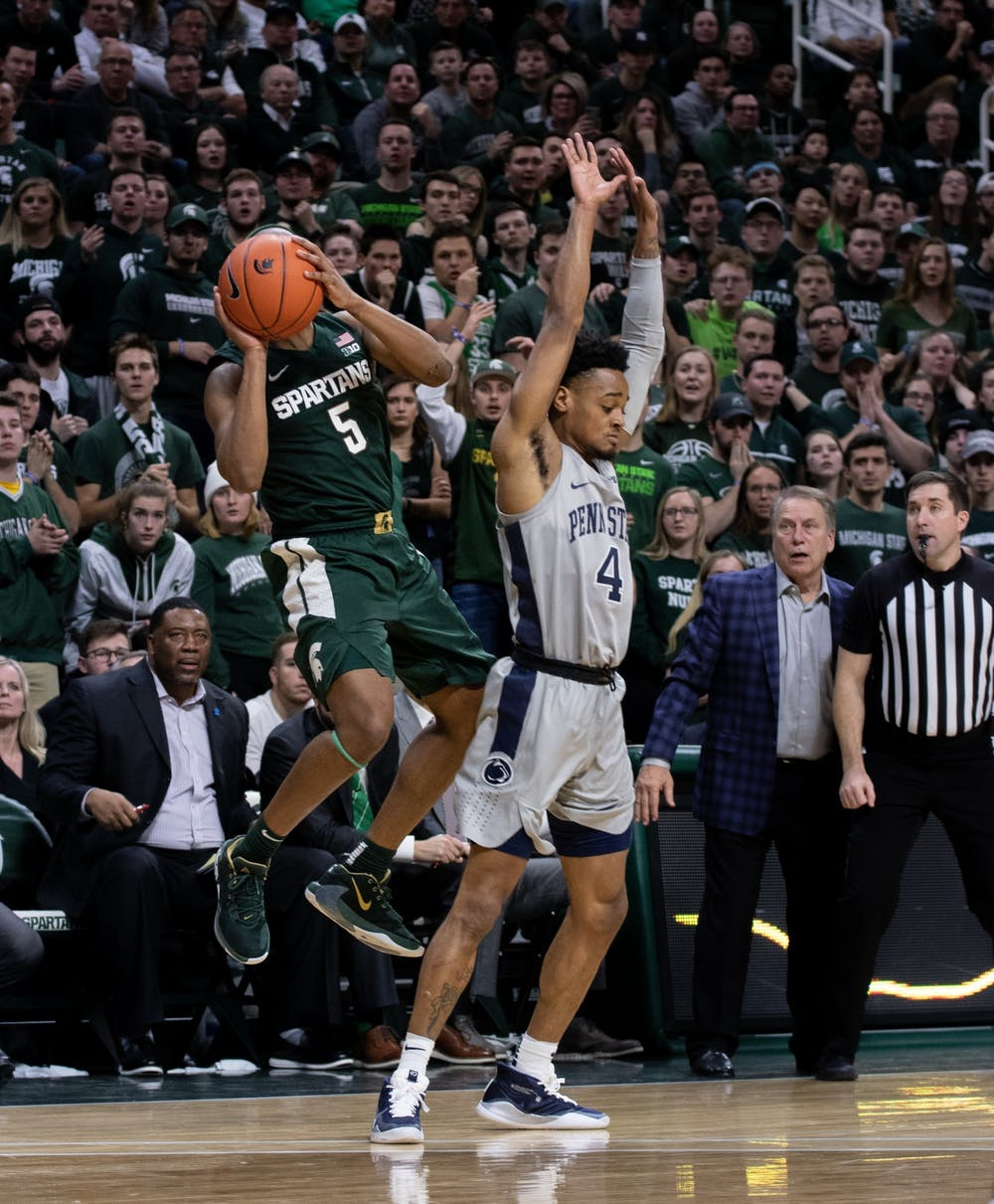 Cassius Winston (5) takes a shot in the final seconds of a basketball game against Penn State at the Breslin Center on Feb. 4, 2020. The Spartans fell to the Nittany Lions, 70-75.
